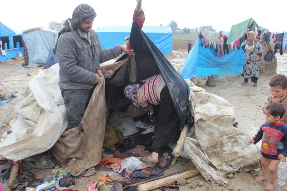 Suriyelilerin çamur içerisinde yaşam mücadelesi galerisi resim 10