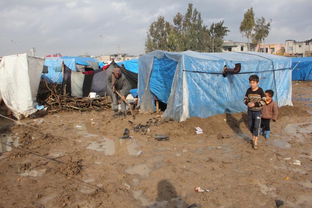Suriyelilerin çamur içerisinde yaşam mücadelesi galerisi resim 13
