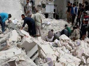 Halep'te hava saldırısında bir aileden 14 kişi öldü
