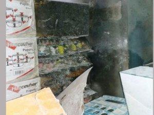 PKK'lılar müşterisiyle beraber marketi yakmak istedi