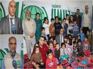 Suriyeli yetim çocuklara mont ve ayakkabı dağıtıldı