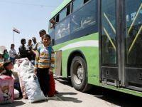 Mudamiye'deki 800 militan, aileleriyle birlikte ilçeden ayrıldı