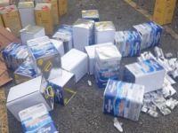 Yağ tenekelerine gizlenmiş binlerce paket sigara ele geçirildi