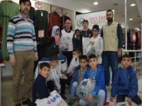 IHO-EBRAR'dan ihtiyaç sahibi çocuklara giyim desteği